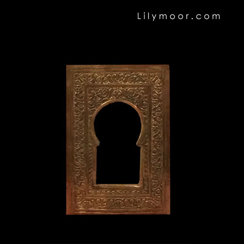 Indian brass mirror for vignette decor